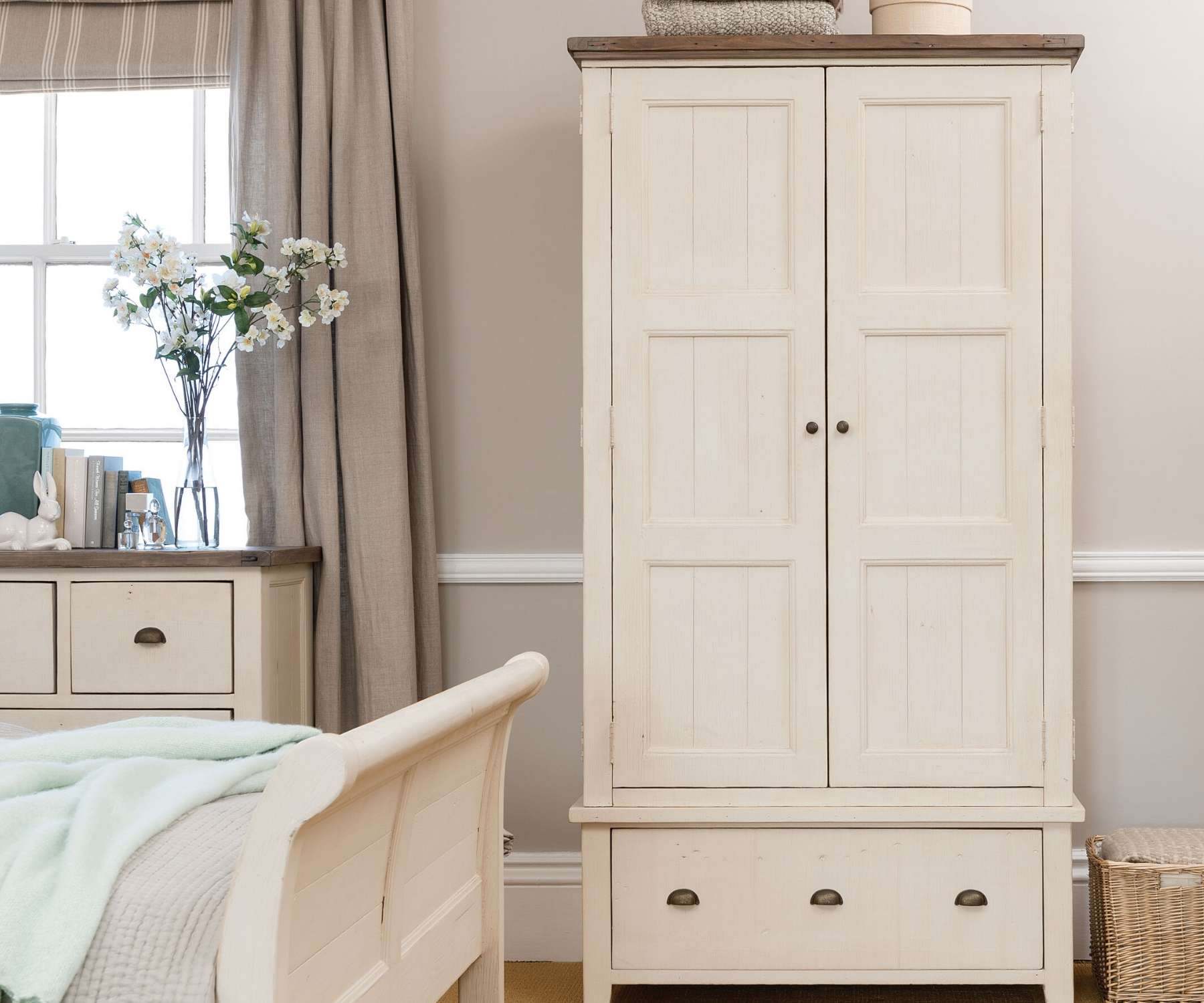 white wardrobe in pale coloured bedroom