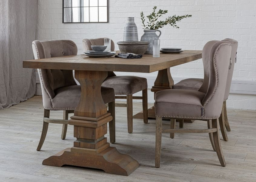 Reclaimed wood dining table with monastery legs and fabric dining chairs
