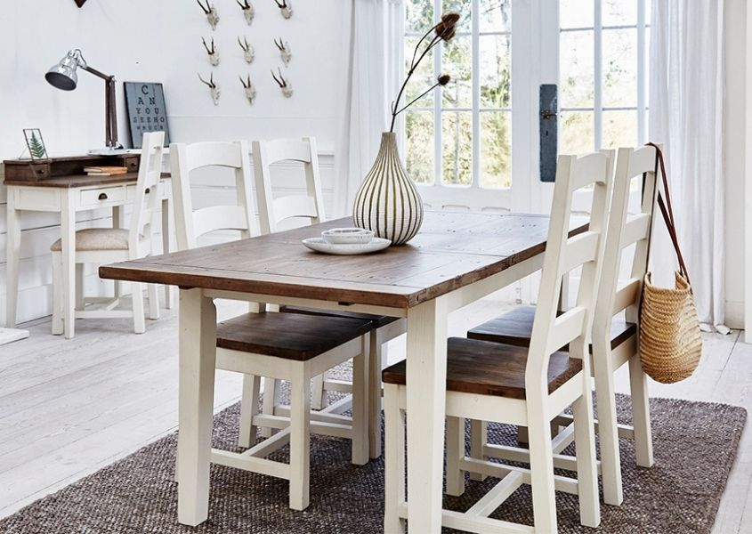 White wooden dining table with natural top and matching chairs with white wooden desk in background