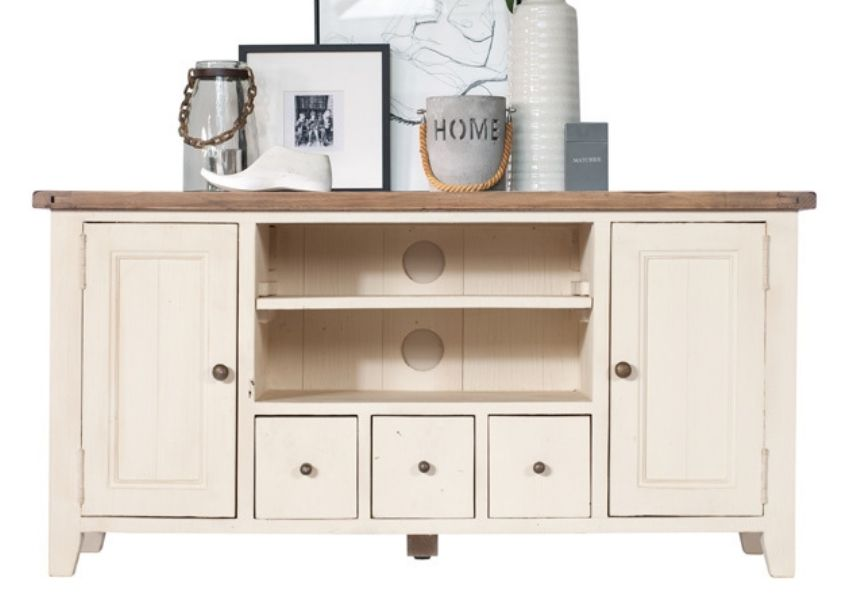 Cut out of white reclaimed wood TV unit with two cupboards and ornaments on top
