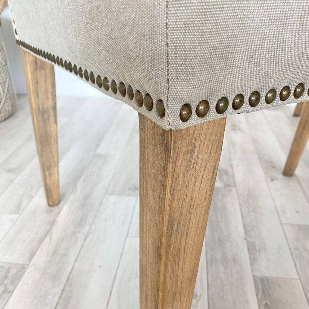 Studs on back and side of ambrose dining chair