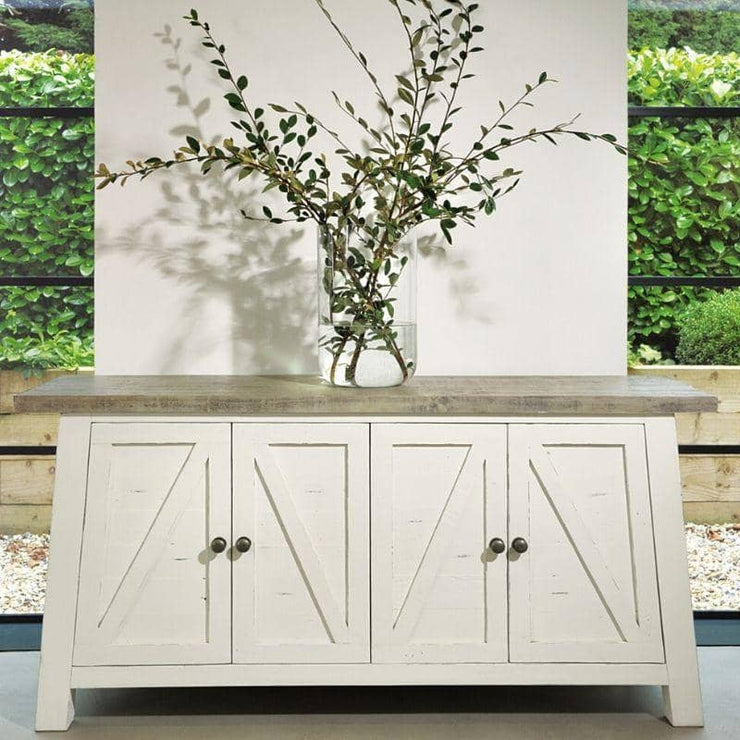 White reclaimed wood sideboard with flowers on top