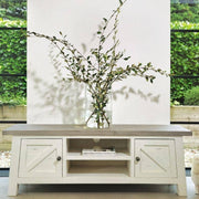 White painted Abingdon Reclaimed Wood TV Unit with flower on top
