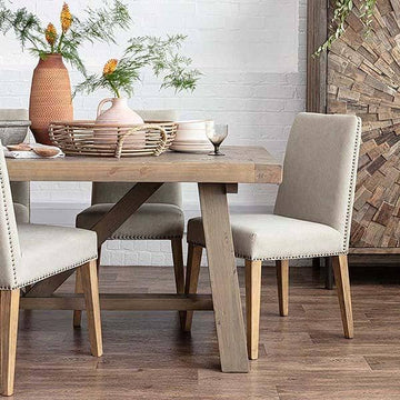 Wooden trestle table with cream fabric dining chairs