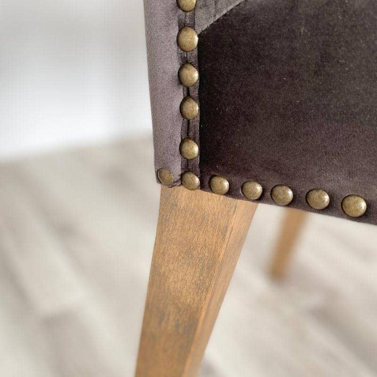 Close up of studding and leg of grey velvet ambrose chair