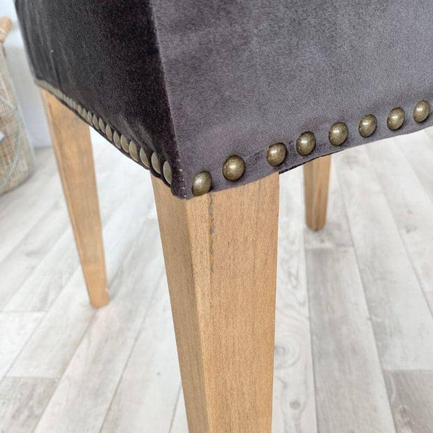 Close up of studding on front and side of chair with leg