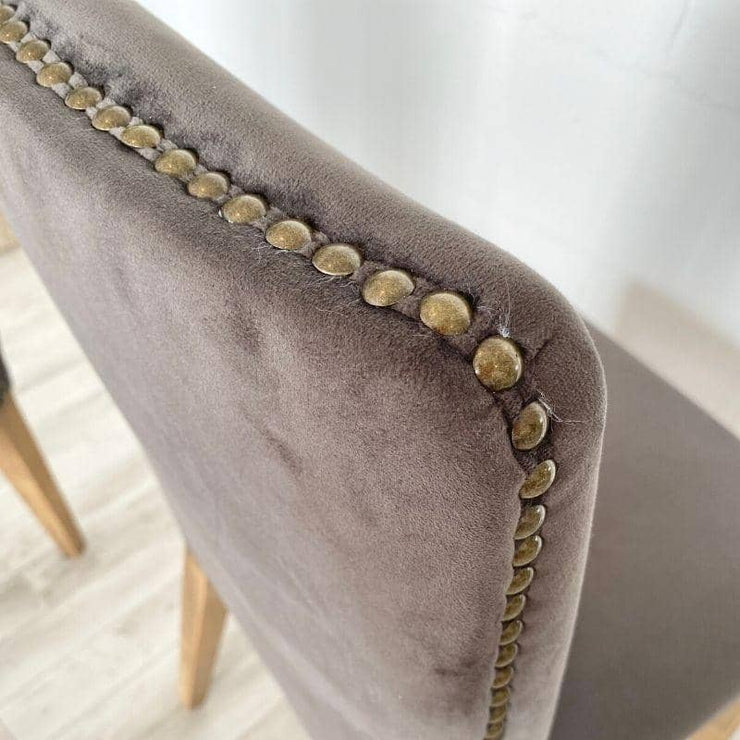 Close up of studding on back of grey velvet ambrose chair