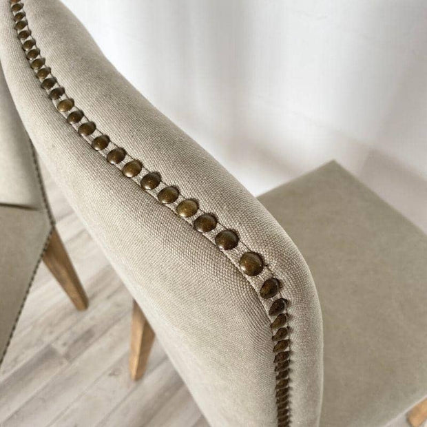 Close up of studs on top of cement coloured ambrose dining chair