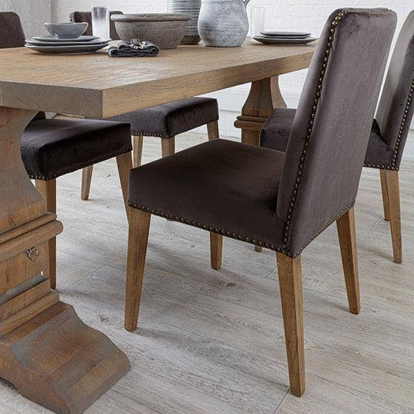 Back of Ambrose Grey Velvet Dining Chairs with studs by Oak Table