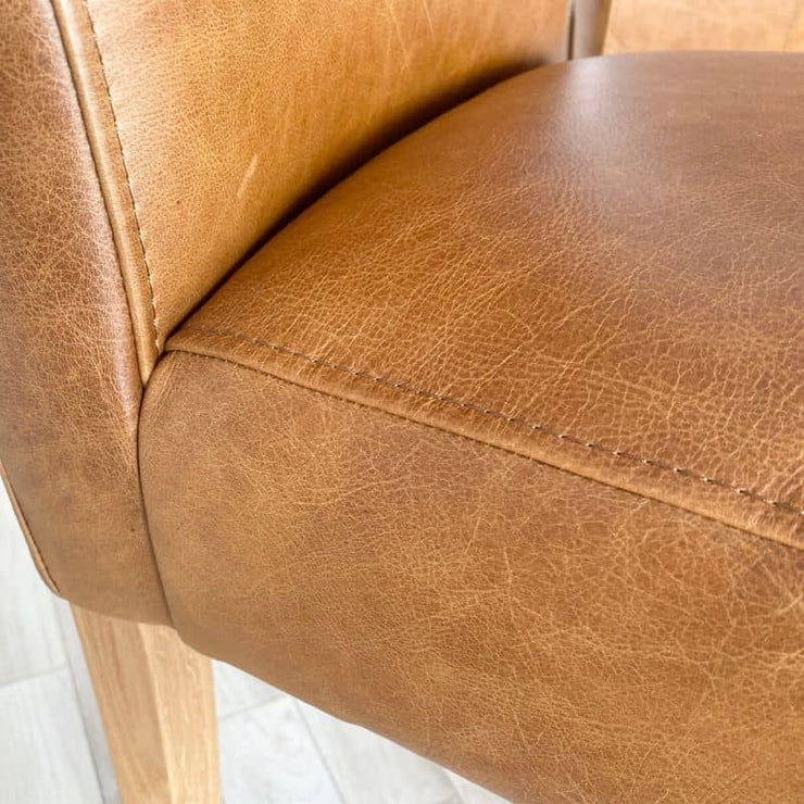 Close up of stitching and leather of seat of roll back chair