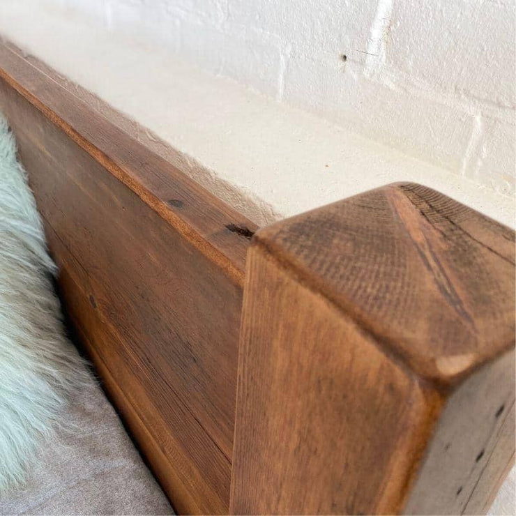 close up of reclaimed wooden headboard