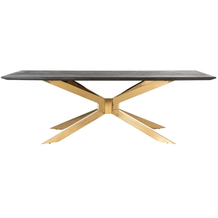 CUt out image of Blackbone Industrial oak dining tbale, showing side profile of gold spider leg.