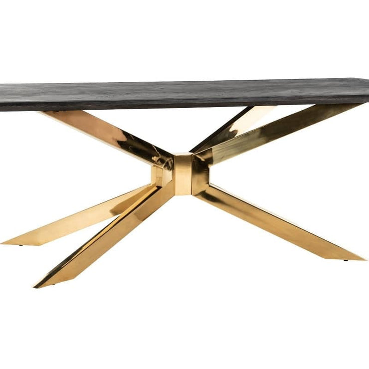 CUt out image of Blackbone industrial oak dining table, at 3/4 angle revealing gold spider leg