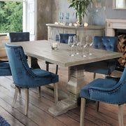 Boston Reclaimed Wood Monastery Dining Table with blue chairs