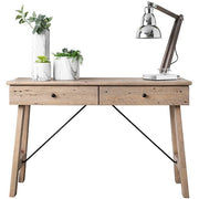 Reclaimed wood console table with a desk lamp and plants