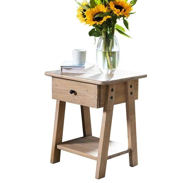 Chelwood Reclaimed wood side table with a bouquet of sunflowers on top