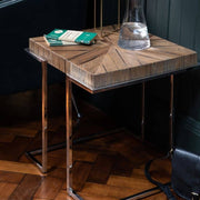 The Knightsbridge Reclaimed Oak Lamp Table with books and a glass vessel of water on it