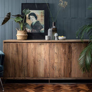 Artwork, ornaments and plants sit atop the Knightsbridge Large Reclaimed Oak Sideboard
