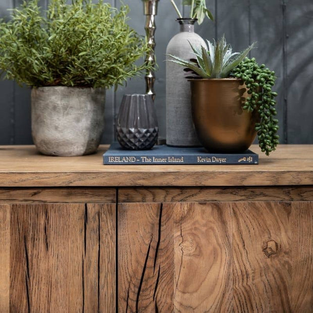 Plants and a book on top of the Knightsbridge Small Reclaimed Oak Sideboard