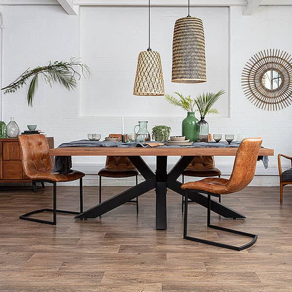 Mitcham Industrial Oak Spider Leg Dining Table and leather chairs