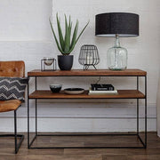 Large oak console table with plant and recycled glass lamp