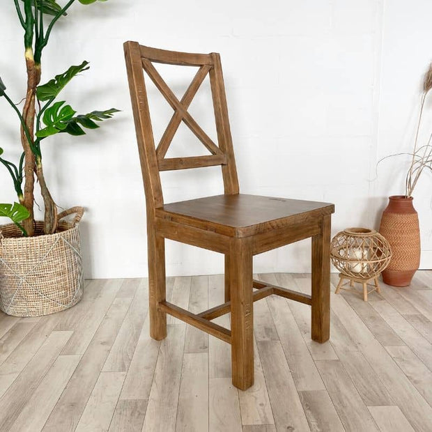 Wooden Standford dining chair with plant and pots
