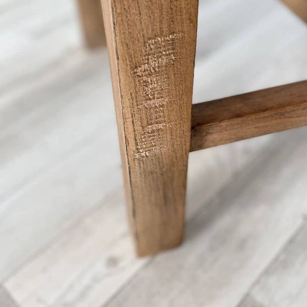 Close up of wooden leg of standford dining chair