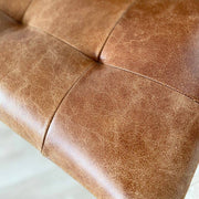Close up of seat of standford leather dining chair
