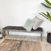 Telford Grey Velvet Dining Bench next to plant