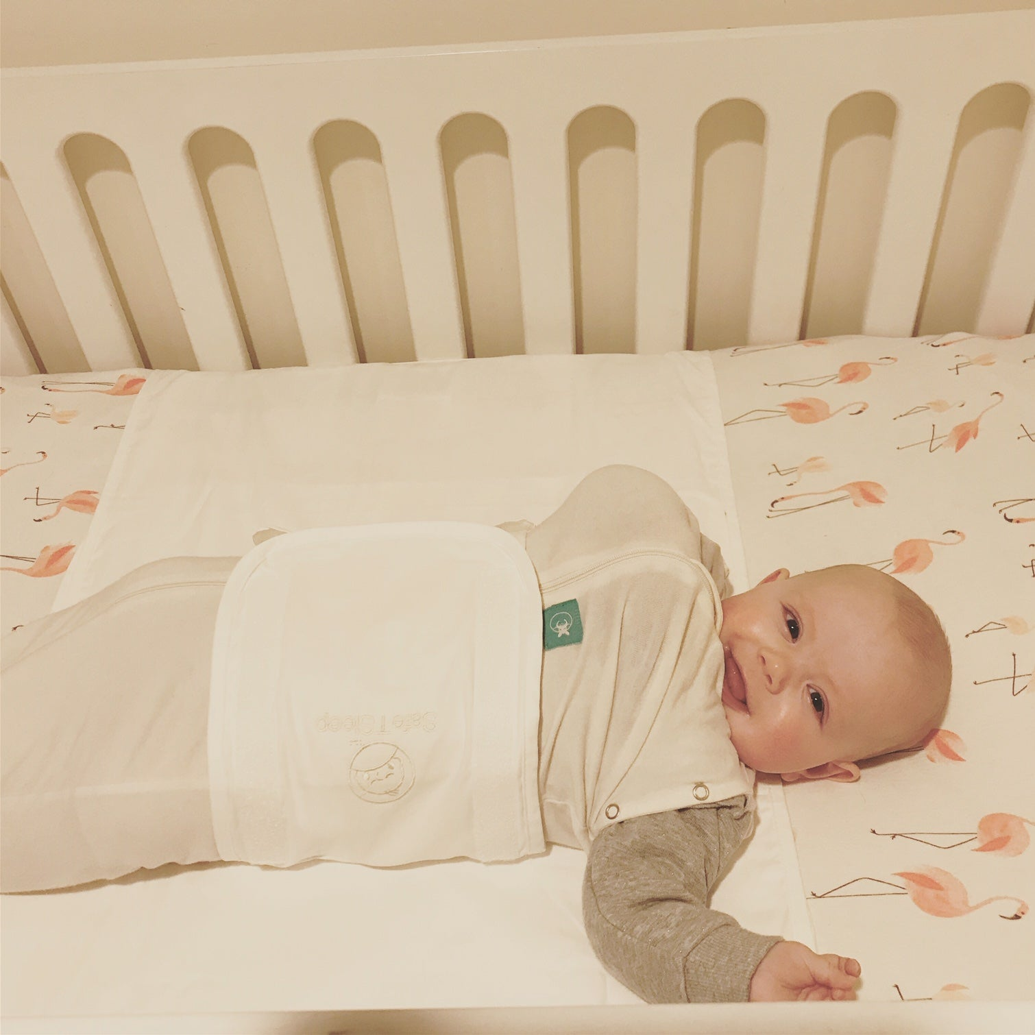 Sleepwrap baby swaddle on a cot/crib