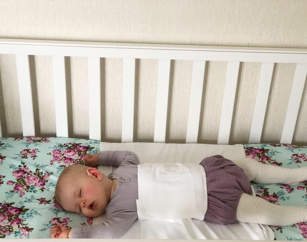 Sleepwrap baby swaddle in a cot/crib