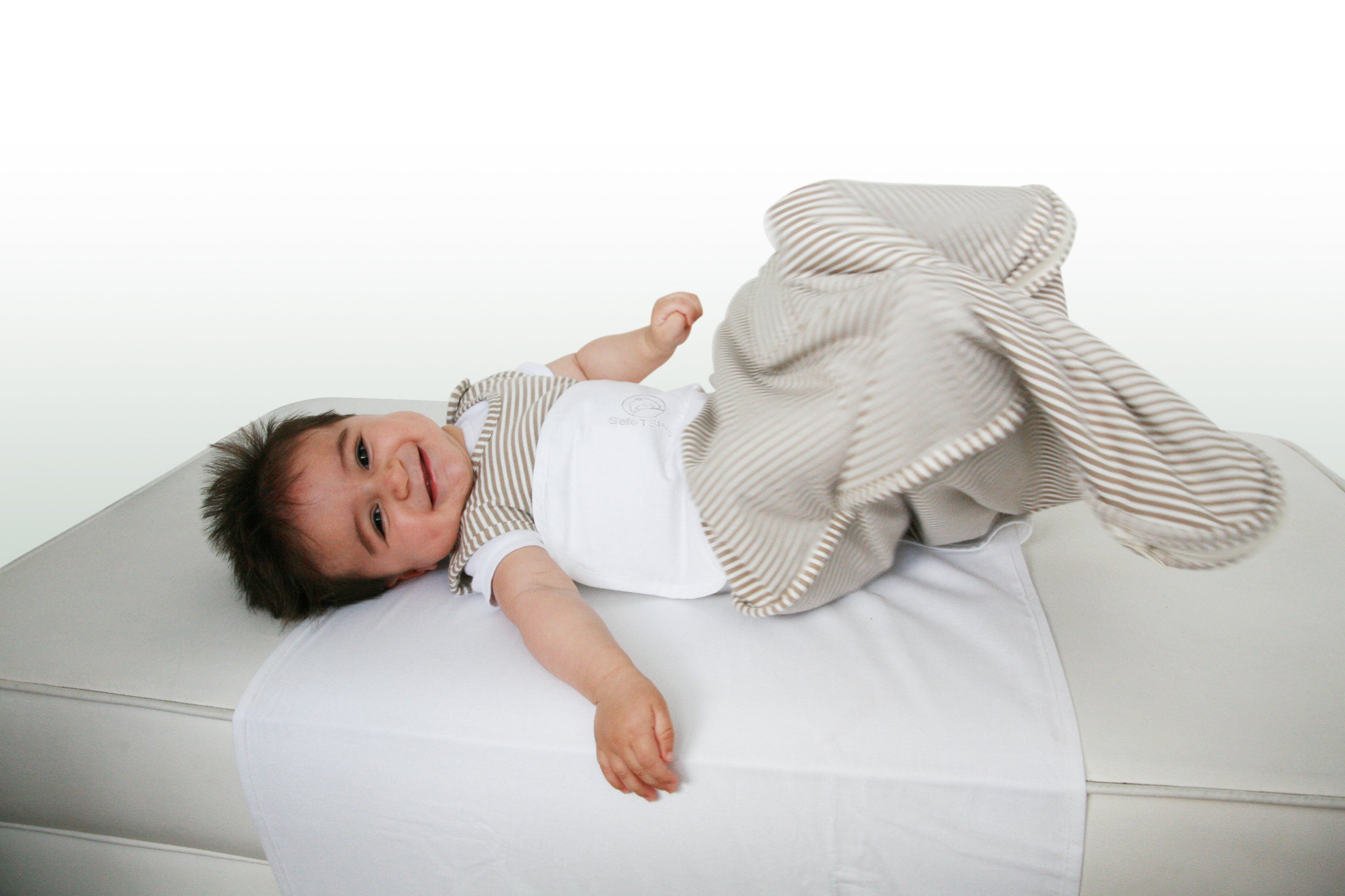 Sleepwrap baby swaddle in a single bed