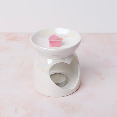 Place wax in burner with tealight