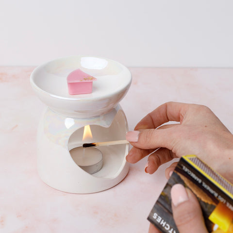 Light tealight and wait for wax to melt