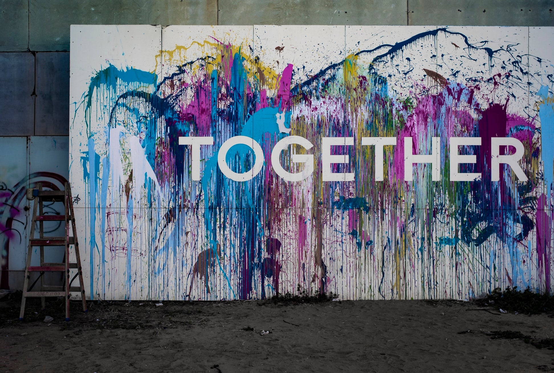 Together on a wall. Displaying that Art Of Heat wants to partner with other people to make our world better.