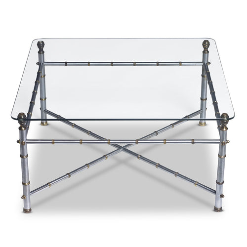A stylish brushed silver and brass bamboo form square coffee table with a glass top