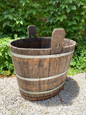 A giant oval, coopered oak and metal banded grape harvesting tub, French 19th Century