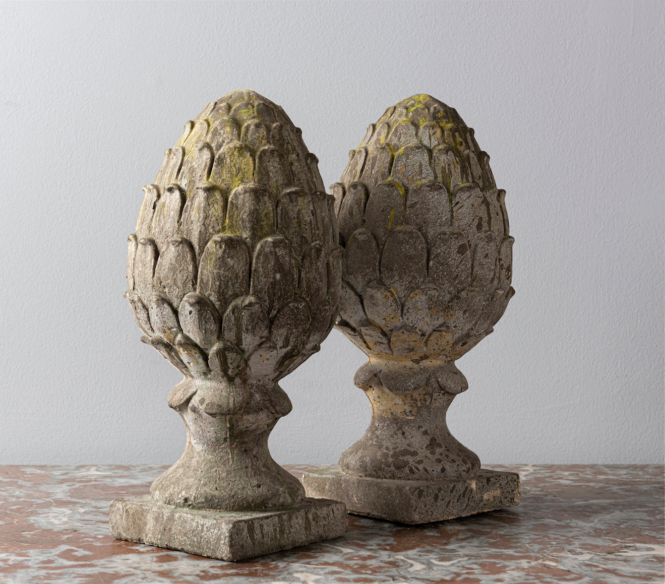 SOLD A pair of composite stone French fir-cone finials