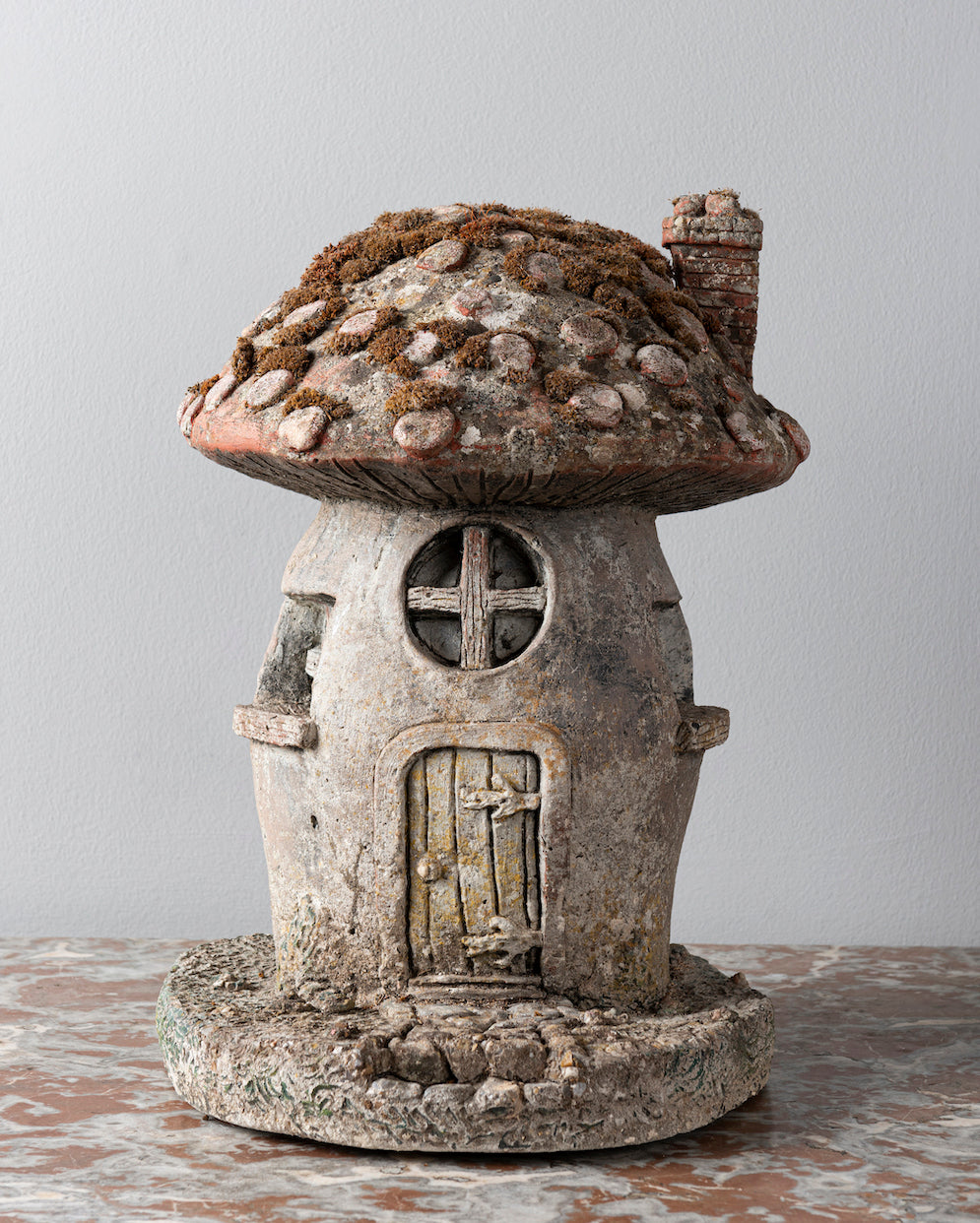 A charming painted French composite stone garden toadstool in the form of a Fairy's house