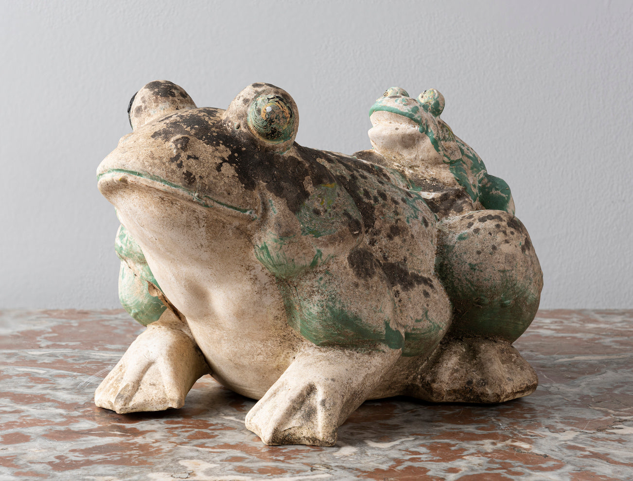 A decorative and charming painted ceramic garden frog