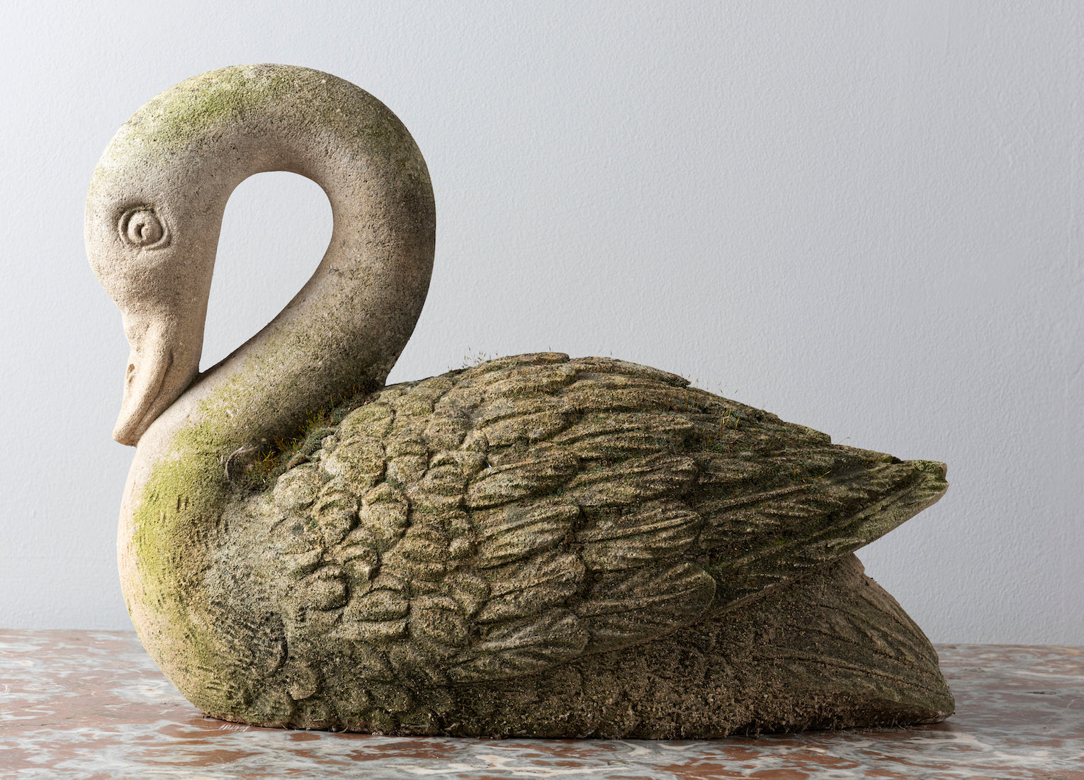 An appealing carved limestone swan sculpture, Italian Circa 1900