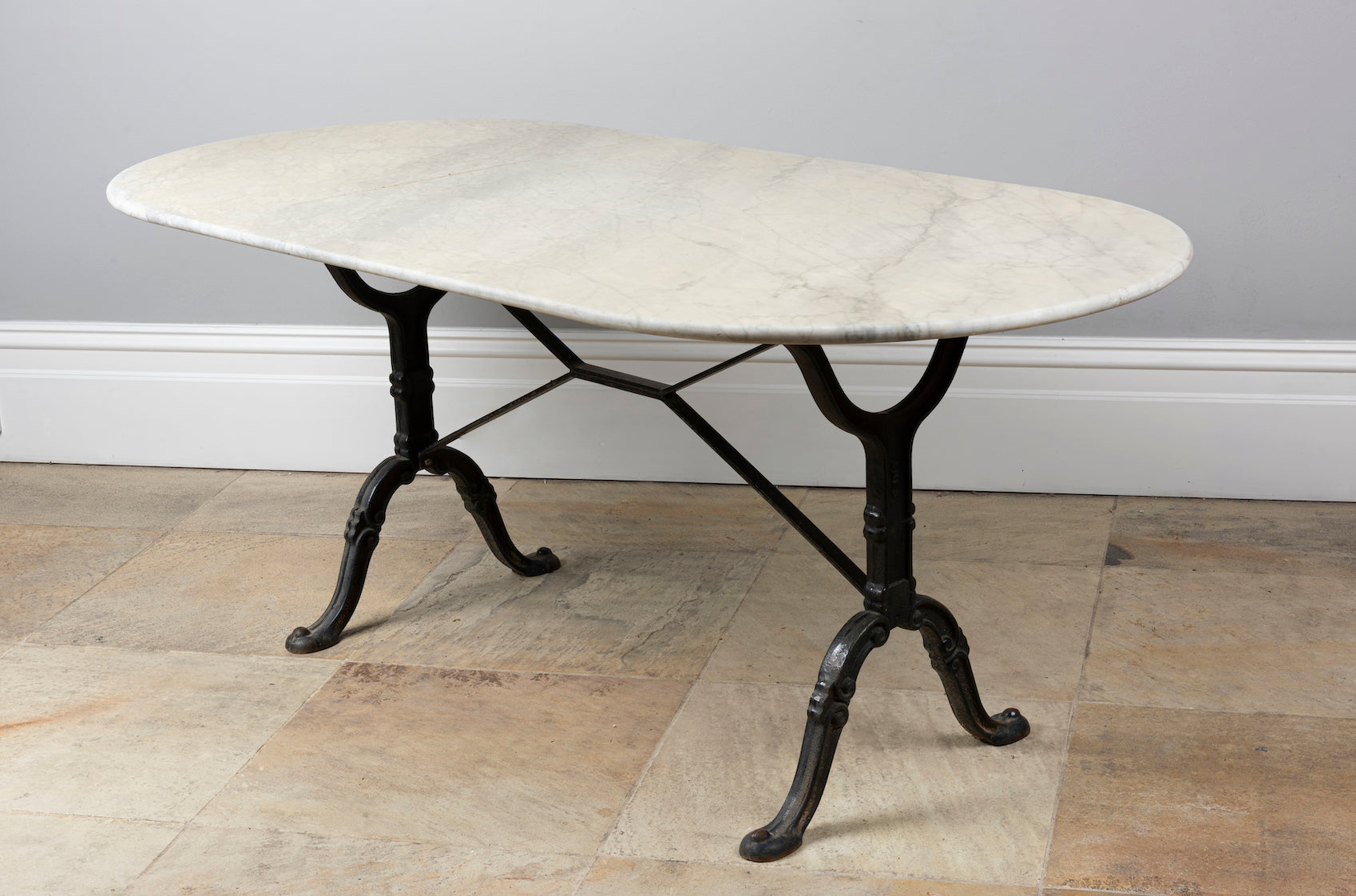 An impressive black painted cast iron garden table with large Carrara marble oval top, French 19th Century