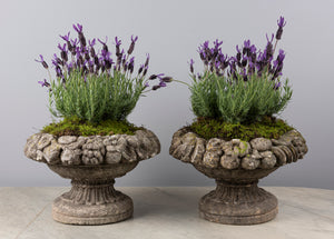 A pair of French circular composite stone jardenieres with fruit borders