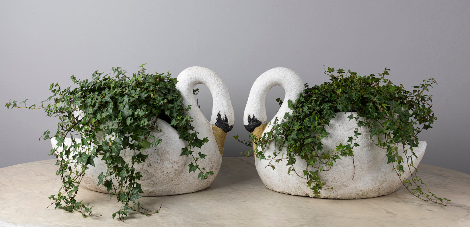 A pair of polychrome painted swan-form jardenieres, French Circa 1950