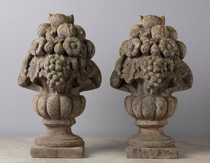 A pair of French composite stone fruit and urn finials
