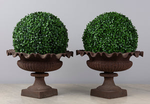 A pair of cast iron pedestal urns with Lily pad borders, French 19th Century