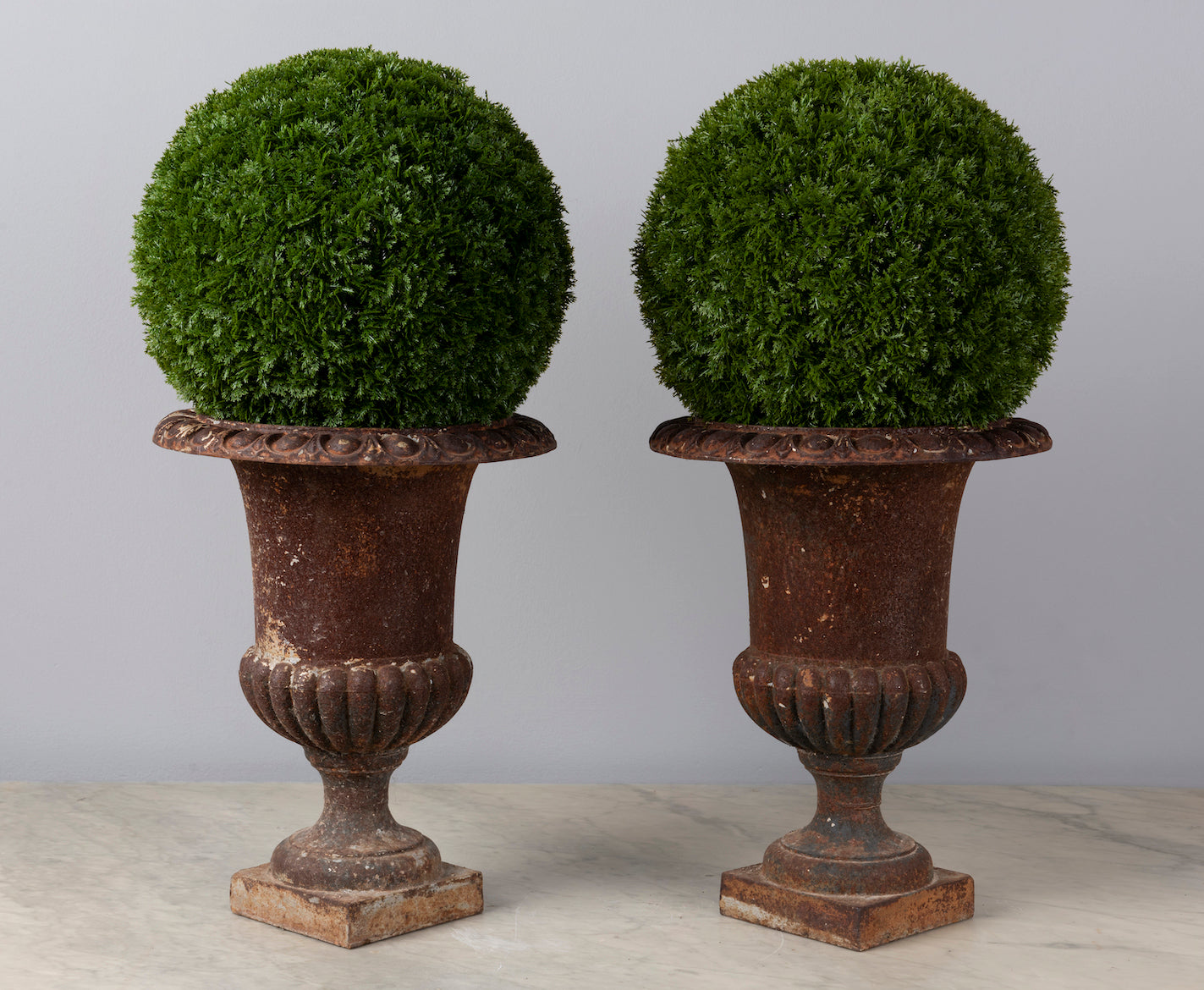 A pair of small decorative cast iron urns, French 19th Century