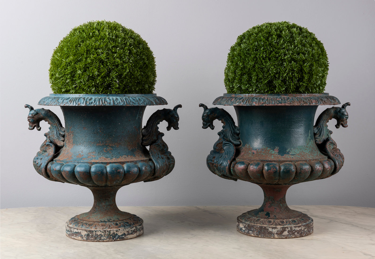 A fabulous pair of dark green painted cast-iron urns with dragon handles, French 19th Century