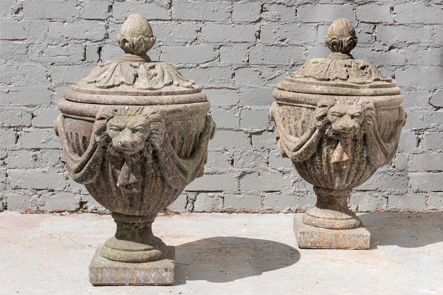An impressive pair of French Neo-Classical style composite stone urns