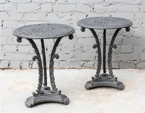 A stylish pair of painted cast iron garden tables-Attributed to Colebrookedale, English 19th Century